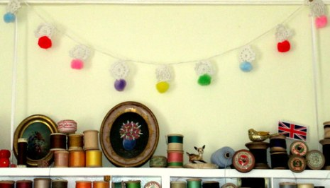 crochet flower and pompom garland